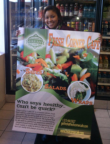 Val Waller, Fresh Corner Cafe co-owner, displays some of the attractive signage that helps a store market fresh food items.
