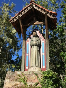 A statue of Fr. Junipero Serra greets you on your way to Carmel proper.